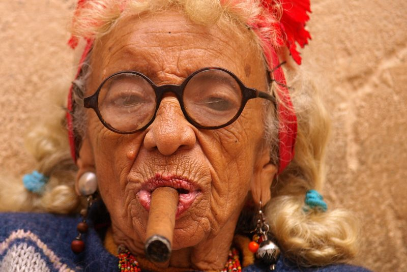 Old woman, 101, smokes fat cigar a day